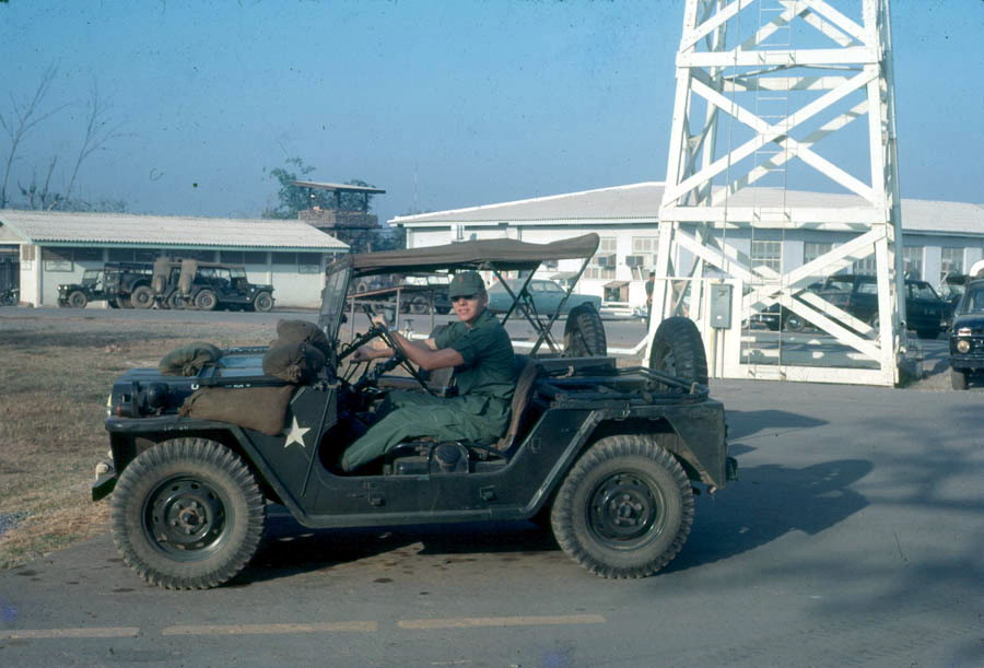John Norris in Vietnam, driving an army jeep, 1968