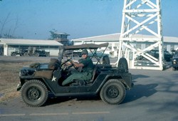 John driving an army jeep